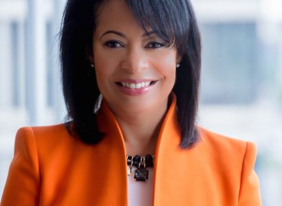deryl-mckissack-orange-jacket-cropped-jpg-optimal
