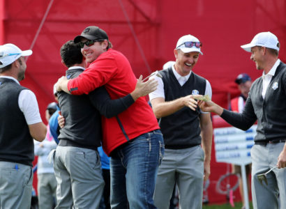 CHASKA, MN - SEPTEMBER 29:  Fan David Johnson of North Dakota hugs Rory McIlroy of Europe after being pulled from the crowd and making a putt on the eighth green as Andy Sullivan, Justin Rose and Henrik Stenson of Europe look on during practice prior to the 2016 Ryder Cup at Hazeltine National Golf Club on September 29, 2016 in Chaska, Minnesota.  (Photo by David Cannon/Getty Images) ORG XMIT: 672193755 ORIG FILE ID: 611393710