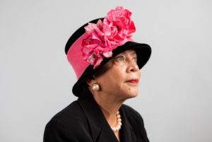 Donna Limerick, daughter of Mae Reeves, wears her favorite hat designed by her mother. The original is housed at the National Museum of African American History and Culture, so she wears a replica. Ariel Zambelich/NPR